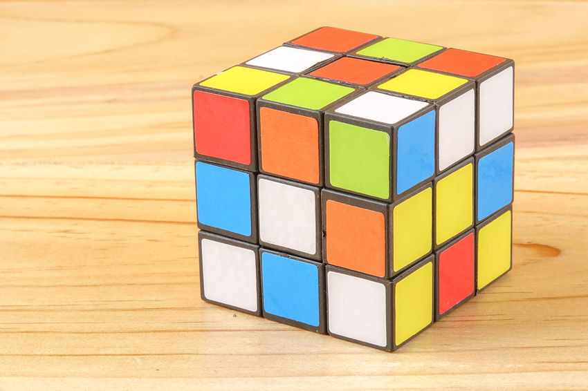 RUBIK'S CUBE , CREATIVITY TOY Creativity Rubik Cube Block Block Shape Close-up Cube Shape Design Focus On Foreground Geometric Shape Indoors  Intelligence Multi Colored No People Puzzle  Rubik Shape Square Shape Still Life Strategy Table Toy Toy Block Wood - Material