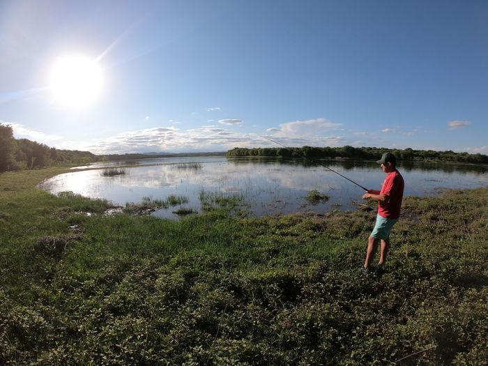 Full length of man on lake against sky