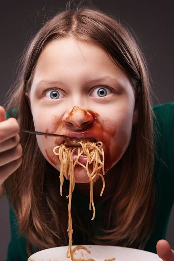 Close-up portrait of a girl eating food