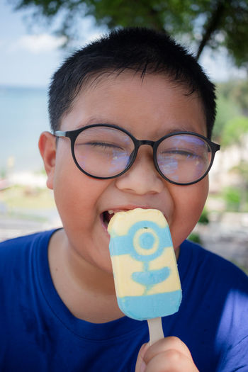 Close-up of boy eating popsicle