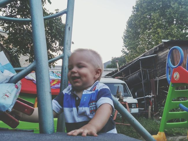 EyeEm Selects Childhood Playground Children Only Leisure Activity One Boy Only Smiling Child One Person Happiness Day Outdoors Boys Playing Sitting Tree People Sky