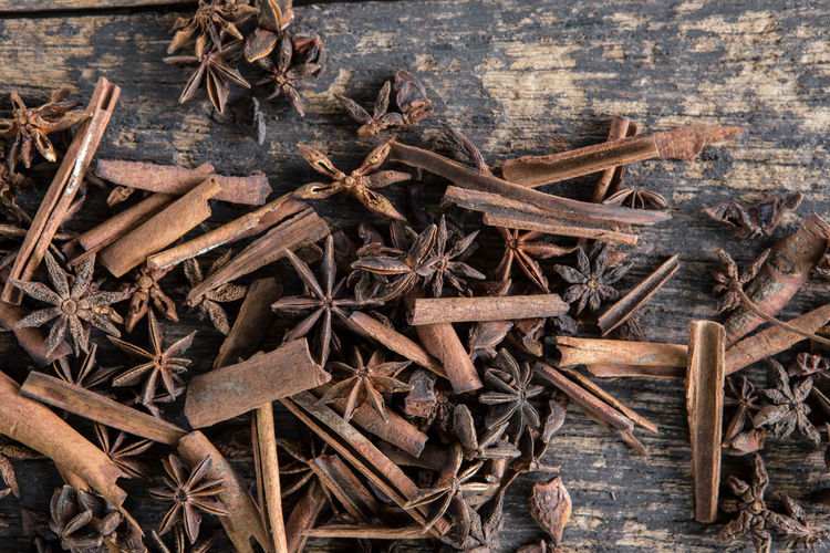 Star anise and Cinnamon on old wooden boards Anise Brown Cinnamon Cinnamonrolls Close-up Directly Above Dried Food Dry Food Food And Drink Freshness High Angle View Ingredient Nature No People Outdoors Plant Spice Star Anise Stick - Plant Part Wood - Material