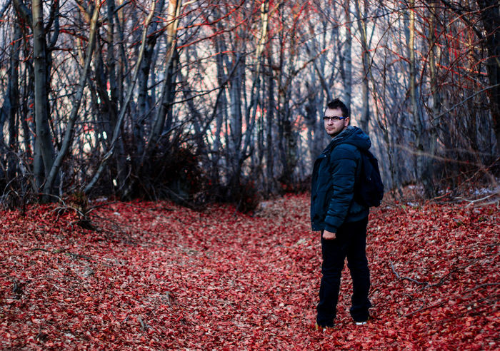 Adult Adults Only Autumn Bare Tree Beauty In Nature Branch Change Cold Temperature Day Forest Full Length Leaf Looking At Camera Men Nature One Man Only One Person Only Men Outdoors People Portrait Protective Glove Red Scarf Tree