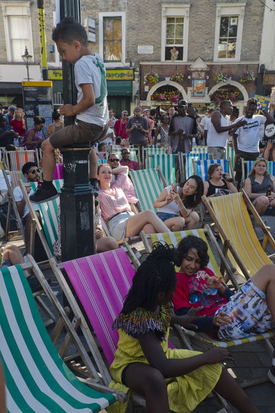 People watch a movie on a outdoor screen in Portobello Road on 8th of July 2018 in London, United Kingdom. Britain is in the middle of a boom in outdoor cinema. (photo by Lorenzo Grifantini) Chair Film Premiere London MOVIE Arts Culture And Entertainment Crowd Group Of People Lifestyles Outdoor Cinema