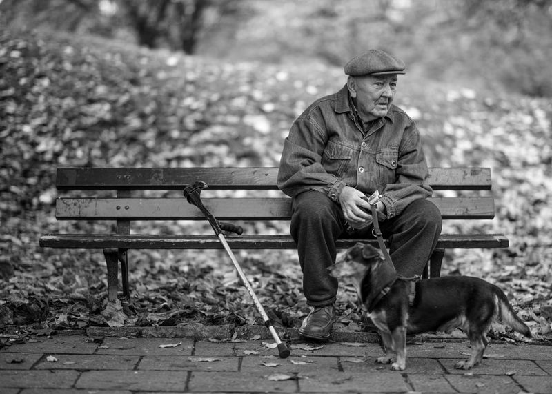 Dog Animal Themes One Senior Man Only Bench Park - Man Made Space Focus On Foreground Domestic Animals Outdoors Pets Adult One Person Day Headwear 1000facesProject 1000twarzy Bwphotography Warsaw Poland Photography Blackandwhite Photography Real People People Men Adult Close-up Headshot