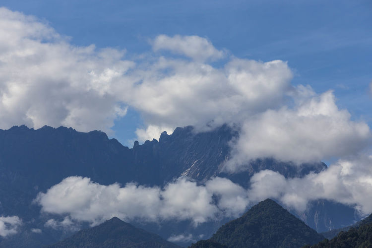 Clouds formation over peak of Mt. Kinabalu. Cloud - Sky Mountain Sky Beauty In Nature Scenics - Nature Tranquil Scene Mountain Range Tranquility No People Nature Environment Landscape Non-urban Scene Idyllic Outdoors Day Tree Majestic Remote Mountain Peak Mt. Kinabalu Kota Belud Sabah Malaysia Cloudscape
