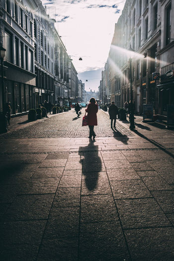 Adult Architecture City City Life Oslo Sky And Clouds Sunlight Backlit Building Exterior Day Full Length Lifestyles Outdoors Street Street Photography Streetphotography Urban Walking Women