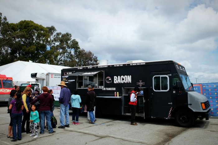 If I'm not mistaken answer's bacon - Maker Faire had it all. Food Truck Outside Bacon Sky Queue via Fotofall