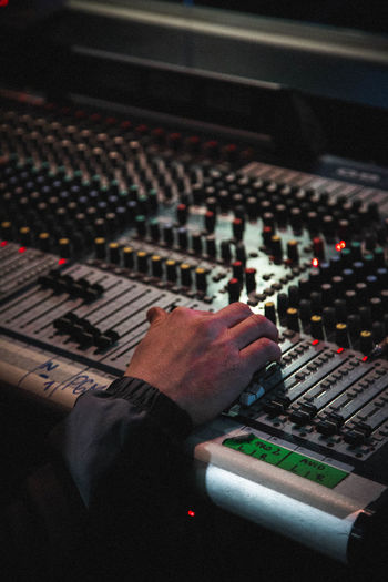 Cropped Hand Of Man Using Sound Mixer In Recording Studio