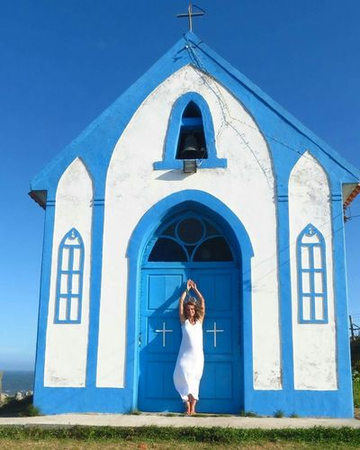 Churches Blue Full Length Sunlight Place Of Worship Clear Sky One Person Arch Sky Real People Outdoors Adults Only Day Adult People
