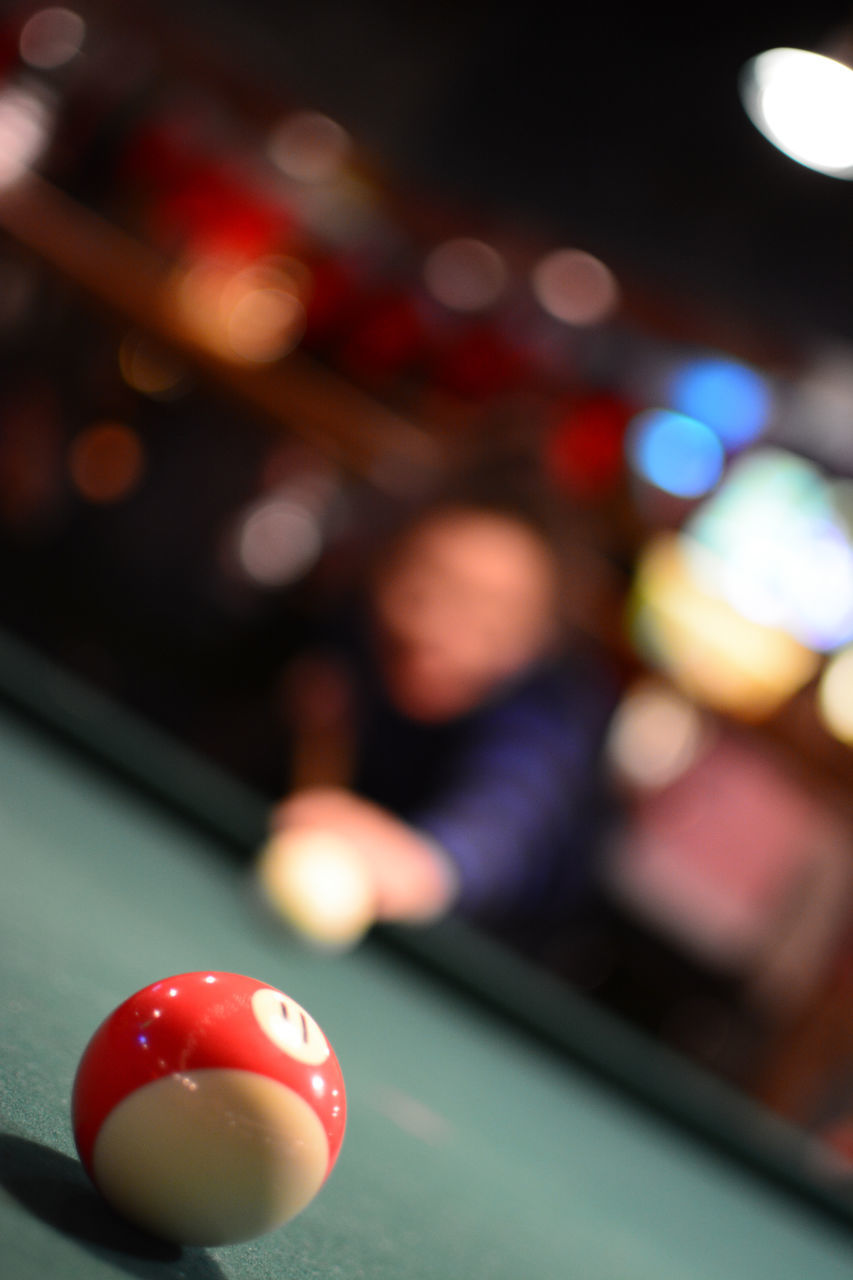 pool table, ball, pool ball, table, indoors, sport, pool - cue sport, leisure activity, focus on foreground, incidental people, close-up, sphere, real people, leisure games, illuminated, still life, multi colored, number, relaxation, red, nightlife