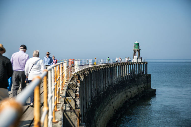 End of the road Pier Whitby Adult Architecture Built Structure Clear Sky Copy Space Day Direction Group Of People Horizon Horizon Over Water Leisure Activity Men Nature Outdoors Railing Real People Sea Sky Travel Water Whitby Pier