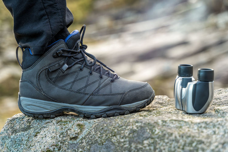 Trekking shoe and binocular closeup on a rock in the mountains during a sunny day, blurred background Shoe Binocular Active Boot Commercial Hike Adventure Advertisement Background Black Blur Blurred Boots Bright Closeup Copy Space Equipment Fitness Focus Foot Grey Health Healthy Hiker Hiking Hiking Boots Inspiration Landscape Leisure Lifestyle Man Mountain Nature Outdoor Outdoors Path Product Rock Shoes Space Sport Sports Summer Tourism Travel Trekking Trendy Trip Walk Woman