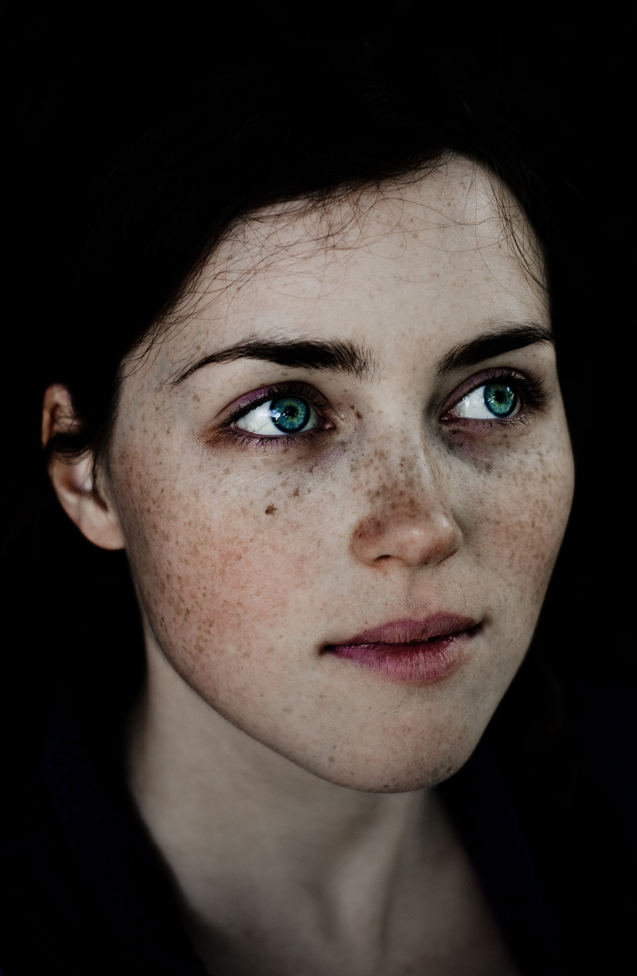 one person, portrait, black background, looking at camera, real people