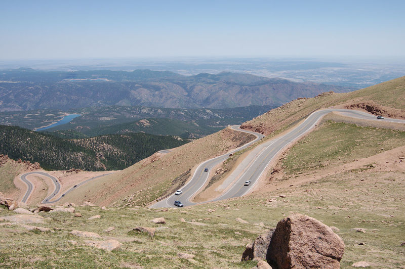 Winding road Pikes Peak In Colorado Arid Climate Beauty In Nature Day Environment High Angle View Idyllic Landscape Mountain Mountain Range Mountain Road Nature No People Non-urban Scene Outdoors Pikes Peak Remote Road Rocky Mountains Scenics - Nature Sky Tranquil Scene Tranquility Transportation Winding Road