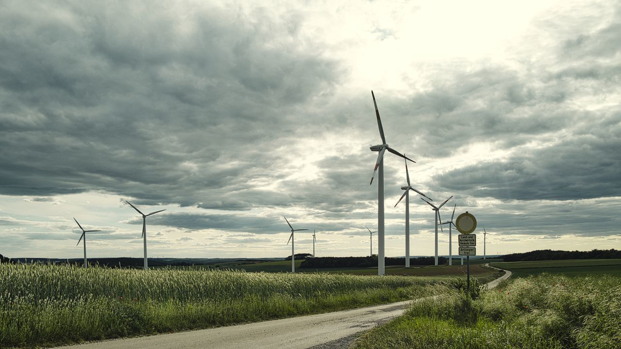 VIEW OF WIND TURBINES ON LAND
