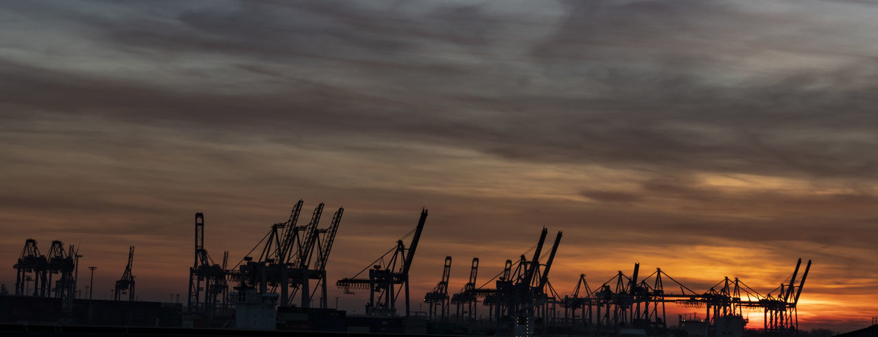 sunset over hamburg harbour Sunset Sky Cloud - Sky Harbor Industry Crane - Construction Machinery Sea Commercial Dock Water Shipping  Transportation Business No People Silhouette Machinery Freight Transportation Construction Equipment Outdoors Sailboat Nature Sky And Clouds Sky_collection Beauty In Nature Colorful Exceptional Photographs The Architect - 2019 EyeEm Awards