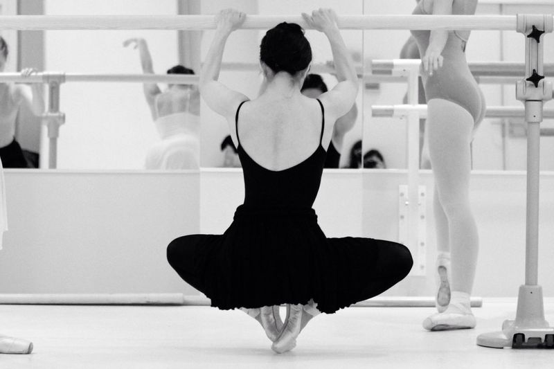 Full Length Of Ballet Dancer Practicing In Studio