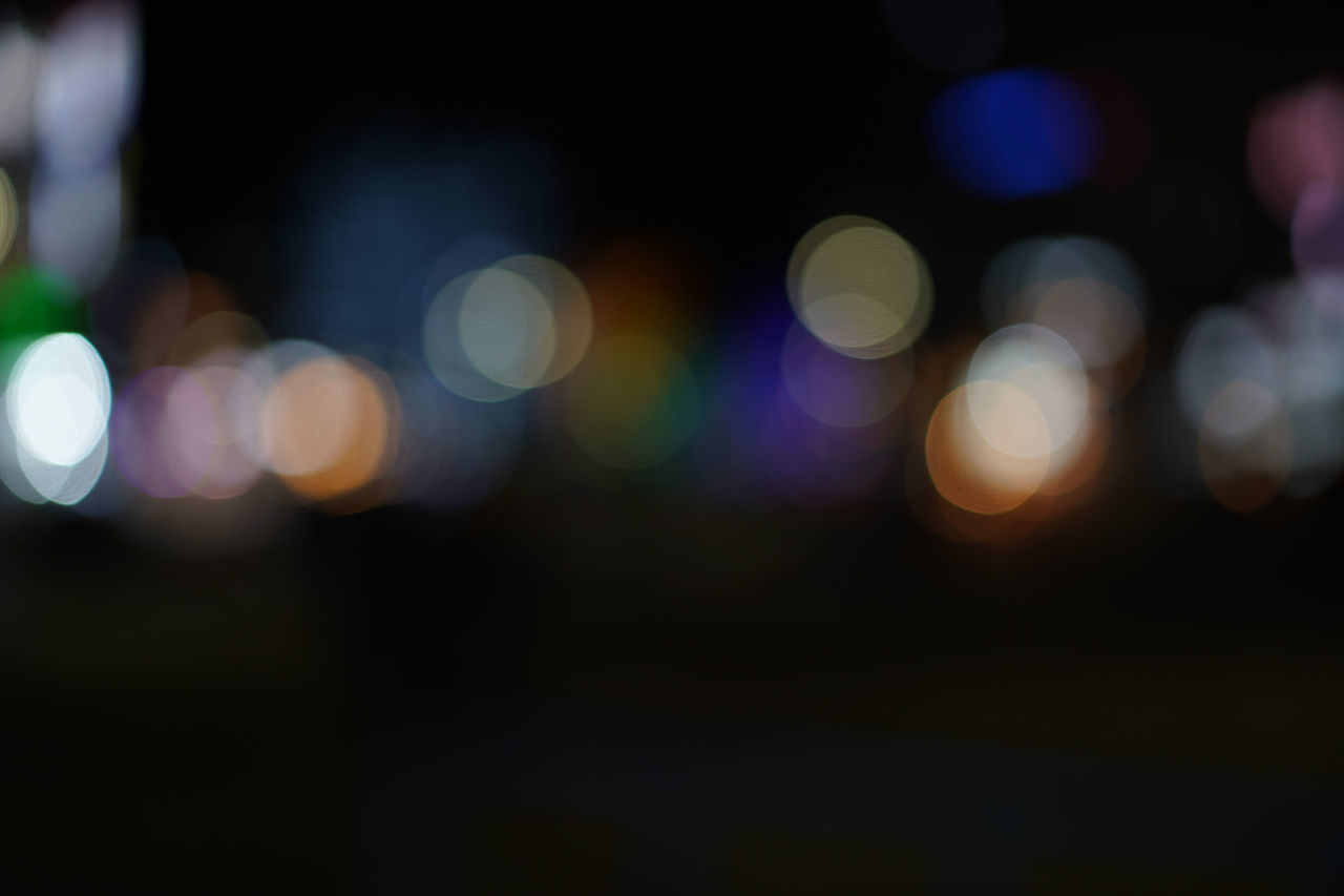 night, defocused, illuminated, light - natural phenomenon, light, circle, glowing, multi colored, no people, shape, geometric shape, lens flare, lighting equipment, electric light, abstract, pattern, backgrounds, light effect, outdoors, blurred motion, electricity, purple, nightlife