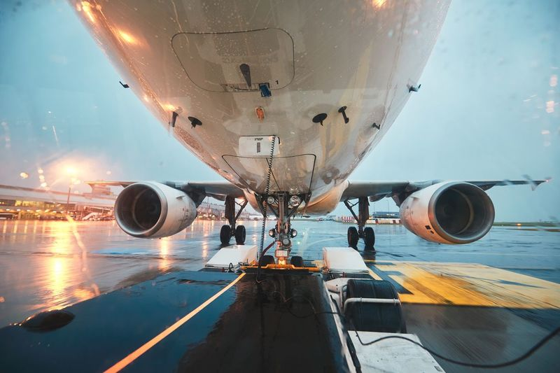 A busy airport in the rain. Push back of the airplane before flight. Cassis Plane Pulling Push Back Rain Storm Transportation Travel Weather Wheel Aerospace Industry Air Vehicle Aircraft Airplane Airport Airport Runway Airportphotography Aviation Aviationphotography Gear Jet Engine Pushing Runway Technology Truck