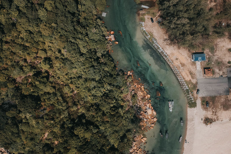Aerial View Architecture Beauty In Nature Day Environment Green Color Growth High Angle View Land Mode Of Transportation Nature No People Outdoors Plant Road Scenics - Nature Transportation Tree Water