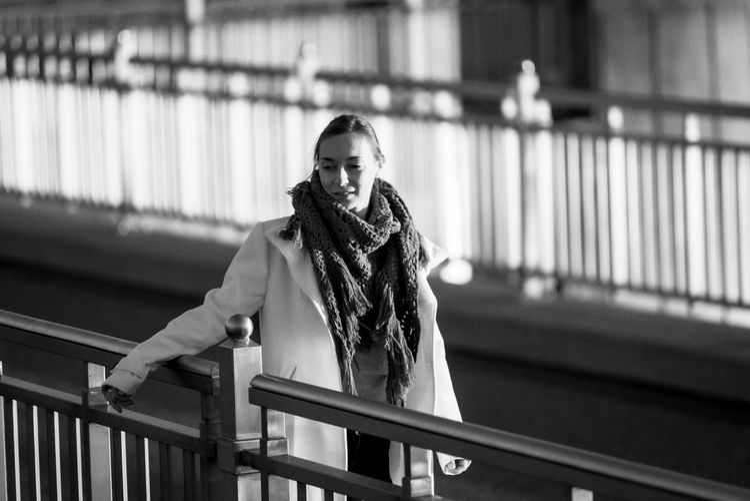 Portrait of woman walking  along a railing
