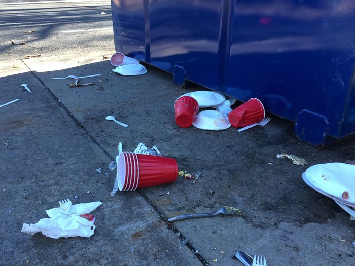 Blue Day Leisure Activity Lifestyles Nature Outdoors Paper Plates Red Red Solo Cup Red Solo Cups Tranquility Trash Trash Can
