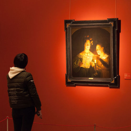 A young girl was watching the painting, Imagination by candlelight, from Petrus Van Schendel. Imagination Imagination By Candlelight Petrus Van Schendel Reading Watching Painting Candlelight Reaction In Front Of Painting Watching Masterpiece