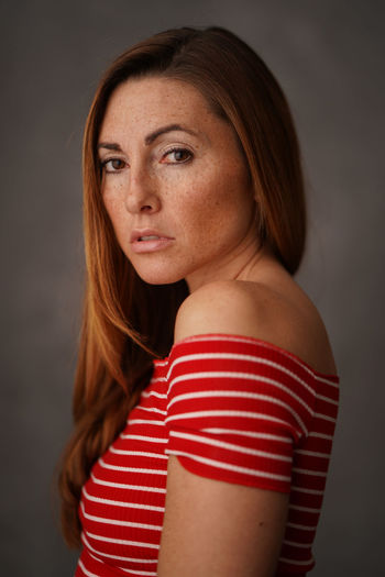 Portrait One Person Striped Studio Shot Indoors  Headshot Women Adult Hairstyle Gray Background Gray Looking At Camera Hair Red Standing Beauty Brown Hair Looking Beautiful Woman Contemplation First Eyeem Photo