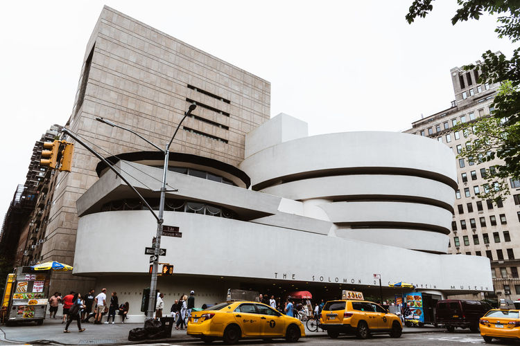 Solomon R. Guggenheim Museum in New York Architecture Day Manhattan NYC NYC Street Photography America American Architecture Solomon R. Guggenheim Museum Museum Frank Lloyd Wright Frank Lloyd Wright Architecture Guggenheim Guggenheimmuseum Guggenheim Nyc Travel Travel Destinations Tourism Tourist Attraction  Built Structure Building Exterior City Transportation Car Street Mode Of Transportation Motor Vehicle Sky Land Vehicle Road Group Of People Real People Building Nature Incidental People Large Group Of People Modern Outdoors Office Building Exterior