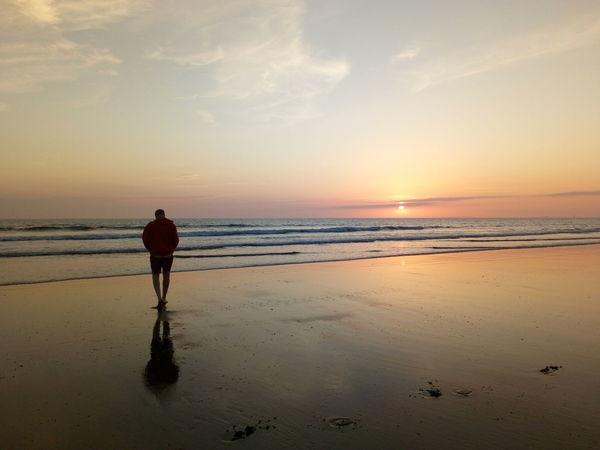 Man walking barefoot towards the sea on a beautiful summer's evening Silhouette Aberystwyth Borth Wales Evening Water Sea Full Length Sunset Beach Sand Standing Summer Silhouette Walking Romantic Sky Salt Basin Wave Tide Coastal Feature