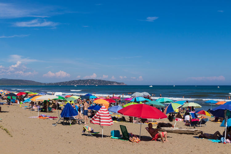 Holiday Tuscany Vacations Beach Beach Umbrella Crowd Day Group Of People Horizon Horizon Over Water Italy Land Large Group Of People Nature Outdoors Parasol Real People Sand Sea Shade Sky Trip Umbrella Water