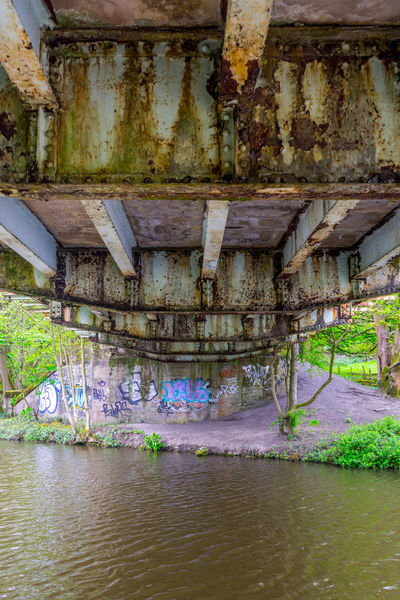 Underneath a rusting bridge on the Leeds Liverpool canal Architecture Beauty In Nature Bridge Canal Derelict Girder Graffiti Iron Metal No People Paint Reclaimed Rust Spraypaint Steel Under A Bridge Under The Bridge Water