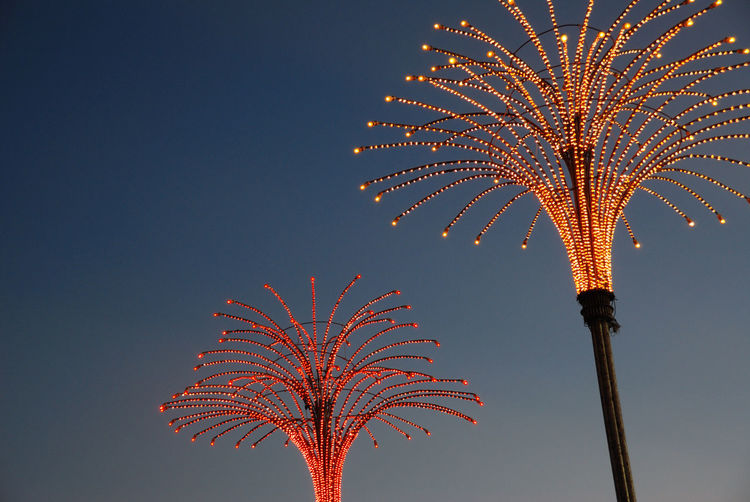 Low Angle View Of Illuminated Decoration Against Sky At Dusk