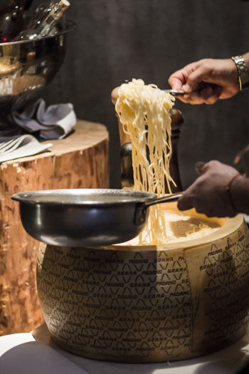 Cropped Image Of Chef Cooking Noodles