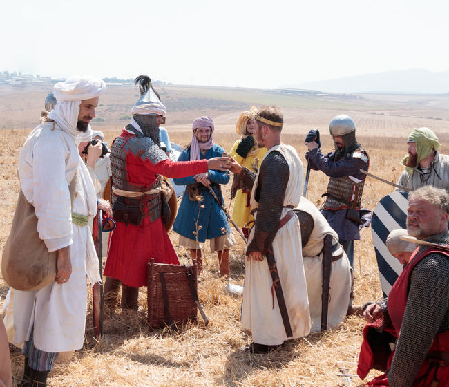 Tiberias, Israel, July 01, 2017 : Participant in the reconstruction of Horns of Hattin battle in 1187 acting as Saladin, talking to the prisoners after the battle near Tiberias, Israel Battle Cross Crusaders Field Fire Guy De Lusignan Hattin Heat Heritage History Horn Horseman Infantry Israel Jerusalem KINGDOM Knight  Muslims Reconstruction Religion Saladin Templars Victory War Weapons