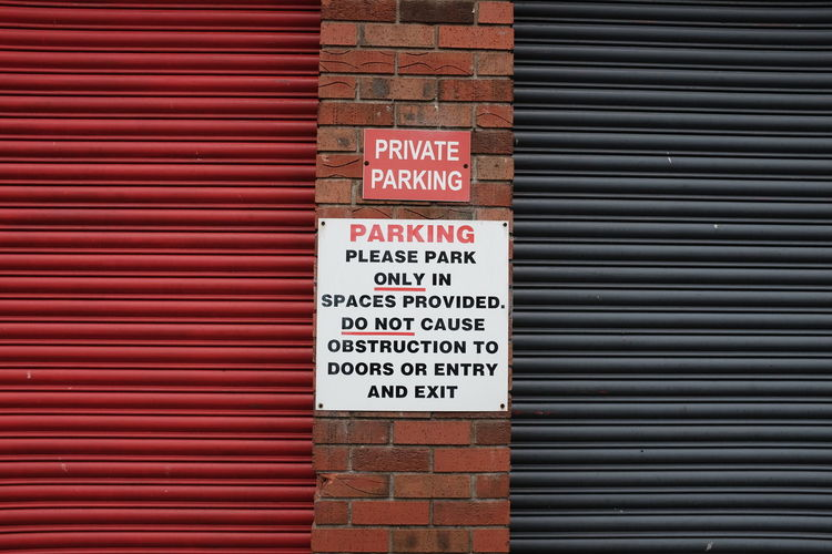 Sign Signs Traffic Architecture Building Exterior Built Structure Close-up Communication Corrugated Iron Day Guidance No Parking Sign No People Outdoors Red Safety Street Street Photography Streetphotography Text Western Script