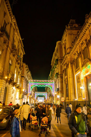 Italy Sicily Architecture Night Building Exterior Group Of People Built Structure Illuminated City Large Group Of People Crowd Real People Men Leisure Activity Women Building Lifestyles Travel Destinations Street Adult Motion Outdoors Nightlife