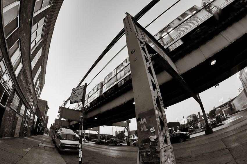 Playing with my Rokinon 8mm lens in Chicago. Bridge - Man Made Structure Transportation Built Structure Architecture Sky Outdoors Low Angle View Day No People Street Photography Architecture Streetphotography Black And White Blackandwhite Low Angle View Mode Of Transport Travel Transportation Chicago Chicago Architecture Streetphoto_bw Streetphotography_bw Traveling Home For The Holidays