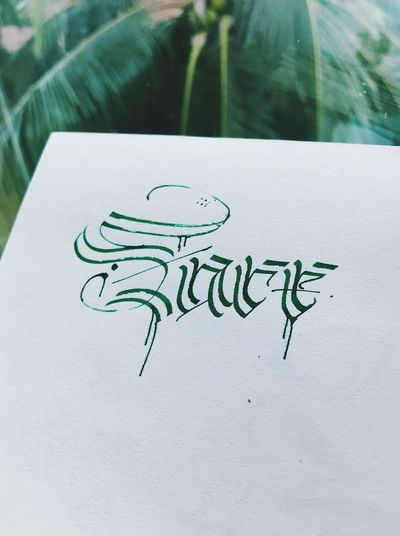 Text Paper Western Script Communication Drawing - Art Product Close-up Creativity Green Color No People Plant Art And Craft High Angle View Activity Representation White Color Handwriting  Nature Publication Indoors  Drawing - Activity Message