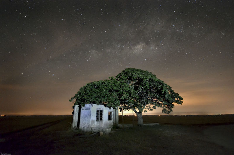 Old House By Tree Against Sky At Night