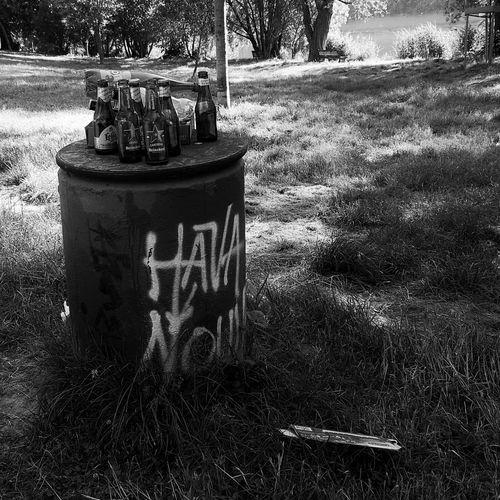 Garbage bin on field