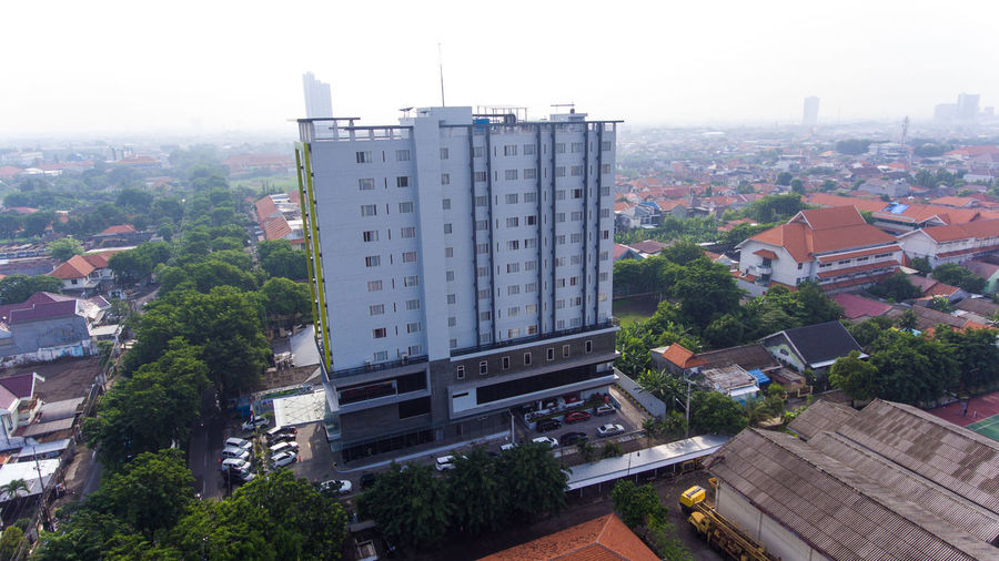 High-rise buildings in urban areas Architecture Building Exterior Built Structure Building City Plant Tree Residential District Day High Angle View Nature No People Cityscape Sky Roof Outdoors House Office Building Exterior Fog Town Skyscraper Apartment Hotel Buildings Surabaya