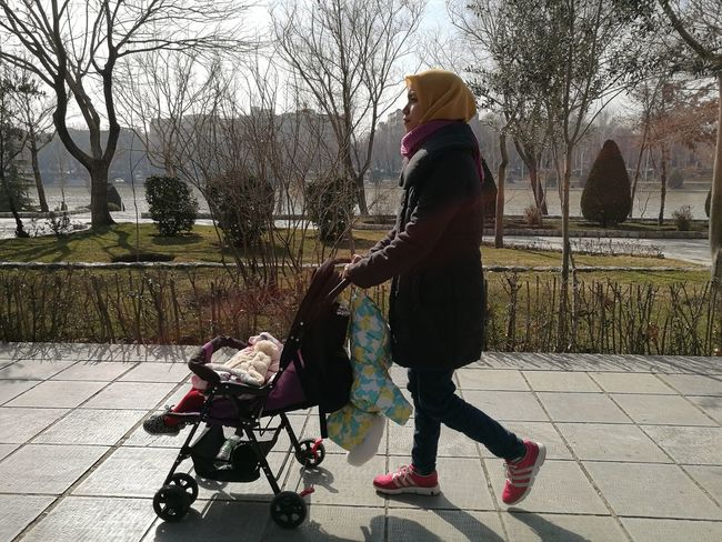 Women Around The World Full Length Walking One Person Adult People Warm Clothing Outdoors Baby Stroller Women Tree Adults Only City Day Sky Only Women Esfahan Iran
