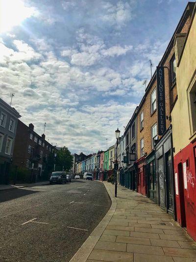 Street amidst buildings against sky
