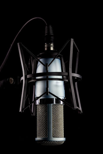 microphone isolated on black background Studio Shot Indoors  Black Background No People Metal Close-up Single Object Equipment Technology Still Life Cut Out Microphone Dark Audio Equipment Sound Recording Equipment Pattern Input Device Copy Space Arts Culture And Entertainment Isolated Isolated On White Copy Space Mcok Up