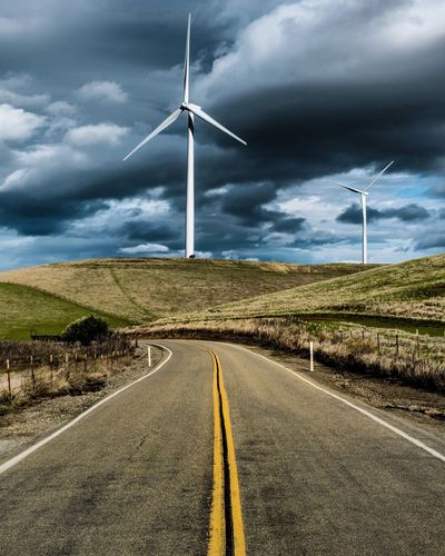 Fuel And Power Generation Alternative Energy Wind Turbine Cloud - Sky Wind Power Road Sky Environmental Conservation The Way Forward Landscape Windmill Renewable Energy Electricity  Nature No People Day Outdoors Industrial Windmill Countryside Technology