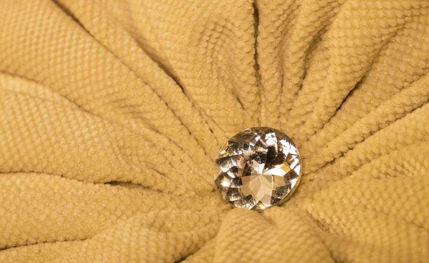 One big brilliant rhinestone diamond style crystal at luxurious golden textile fabric 43 Golden Moments BIG Close-up Crystal Decor Decoration Design Detail Diamond Element Fabric Furniture Golden Interior Luxurious Luxury Macro One Plait Premium Rhinestone Sparkle Style Textile Pivotal Ideas