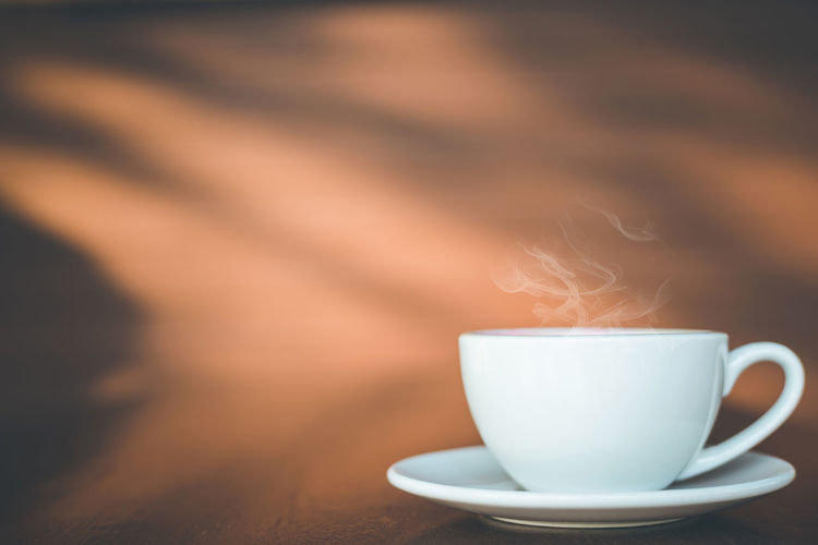 Close-up of coffee cup on table