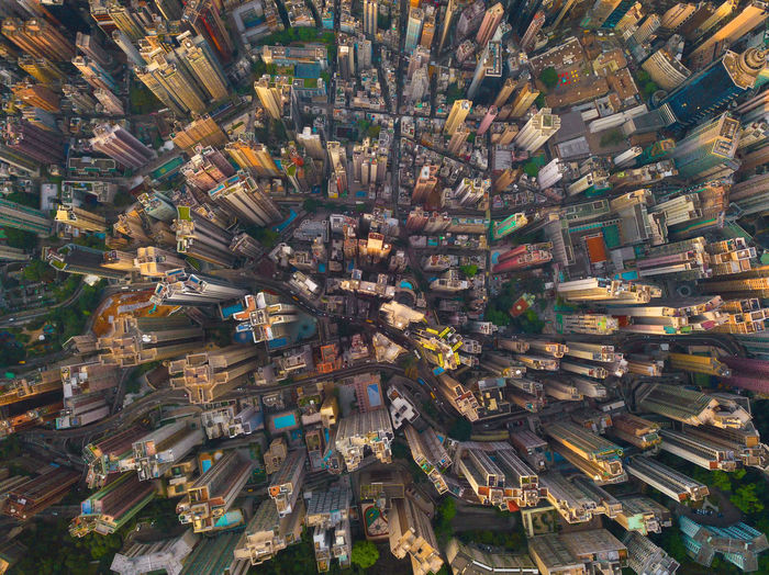 Aerial view of Hong Kong Downtown, Republic of China. Financial district and business centers in smart city in Asia. Top view of skyscraper and high-rise buildings at sunset. City Cityscape Aerial View Drone  Hong Kong HongKong Urban Downtown Above Financial District  Top Business Network Connection Landscape ASIA Buildings Skyscrapers High Angle View Architecture Building Exterior Built Structure No People Day Building Full Frame Backgrounds Outdoors Community Nature Residential District Travel Destinations Transportation